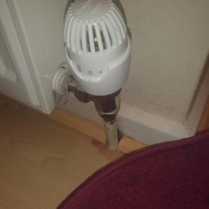 Plumber Clifton plumbing radiator dial up close